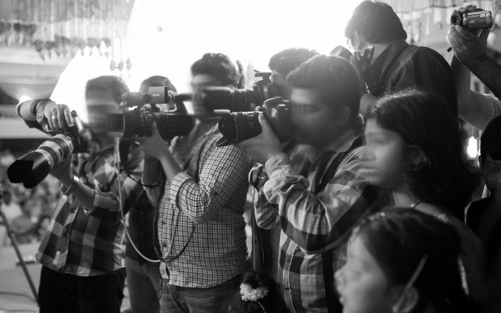 many photographers in a single wedding